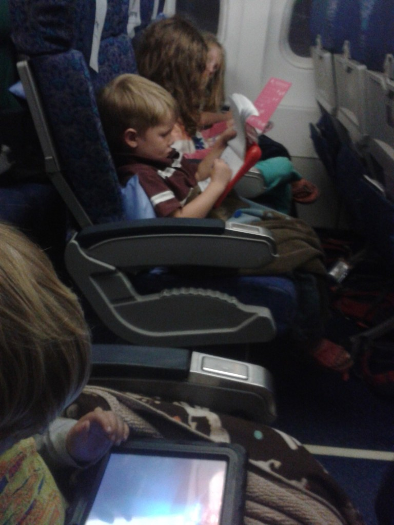 22-on the airplane ready to see Dad...cuties
