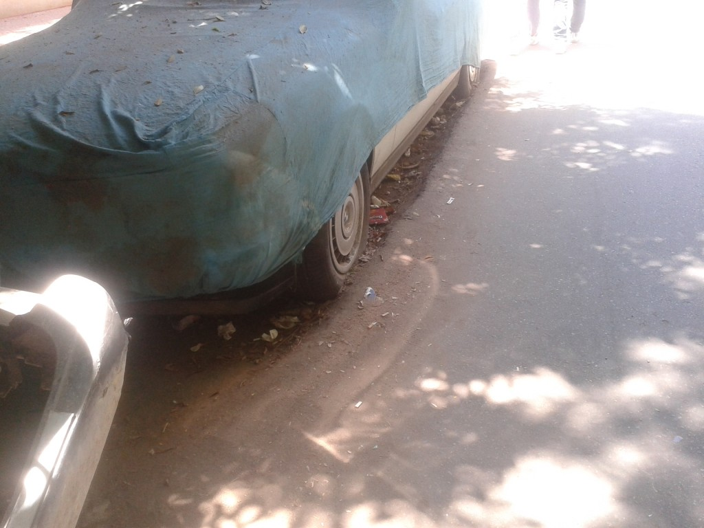 17-a car cemented into the street instead of being towed...