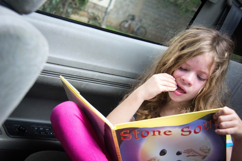 Still running errands but enjoying reading aloud to her brothers in the car...