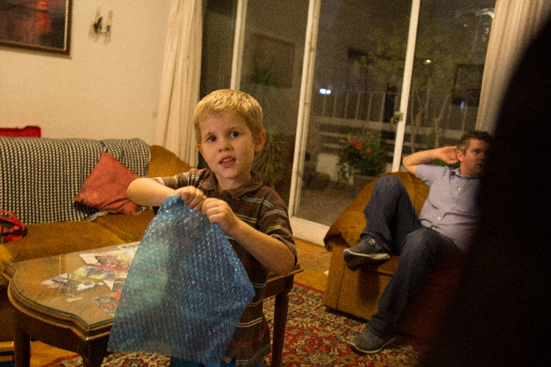 One of his favorite gifts - bubble wrap of course!