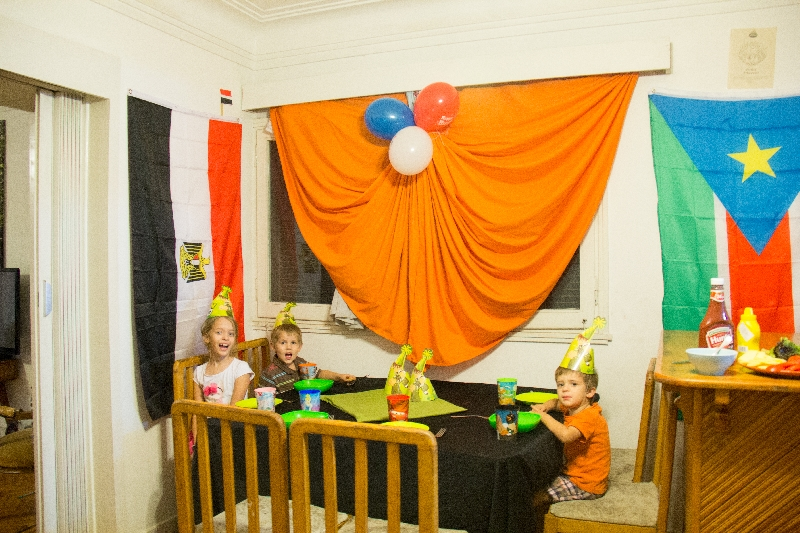 The girls decorated with some balloons and hats and we prepared for guests to arrive that evening to help us celebrate W-man
