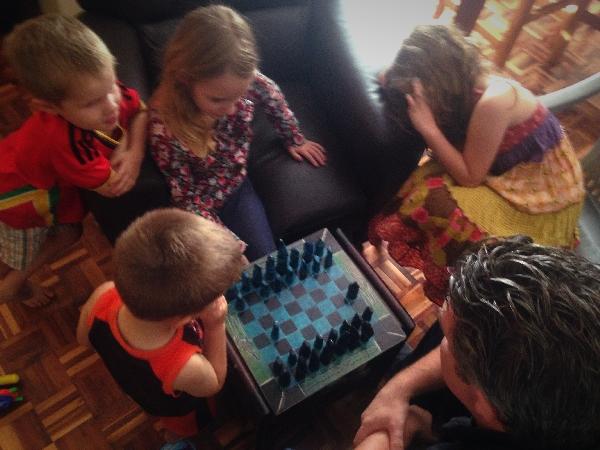 01.16-J-- teaching the kids chess. They love it!