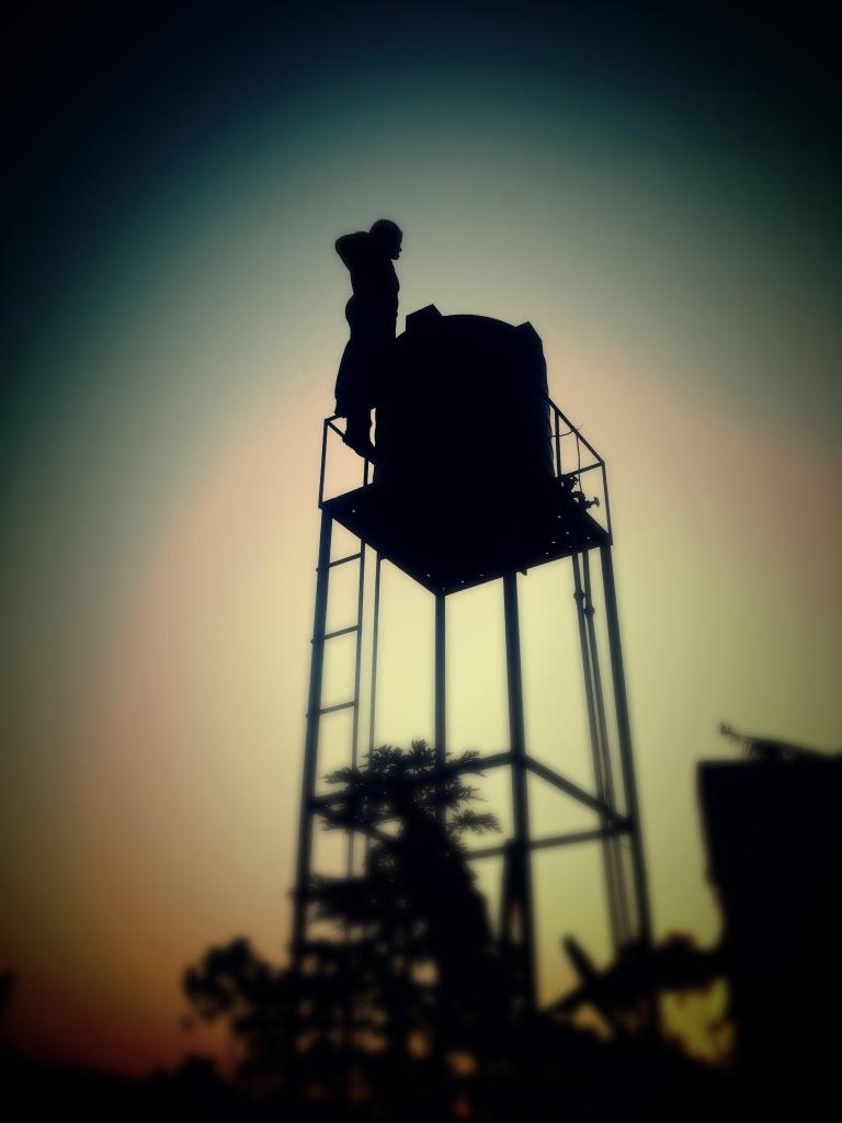 01.07-My man fixing the water tank in Uganda